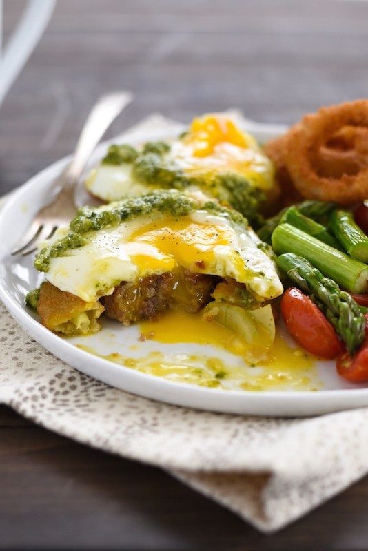 Onion Ring, Sausage & Egg Stacks - Onion rings for breakfast, or breakfast-for-dinner! Onion rings, sausage, and eggs are stacked and topped with basil pesto. | foxeslovelemons.com