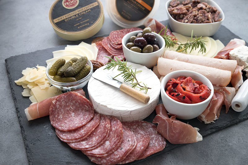 Keto charcuterie board with an array of meats and cheeses