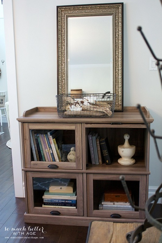One cabinet styled three ways / mirror on cabinet - So Much Better With Age
