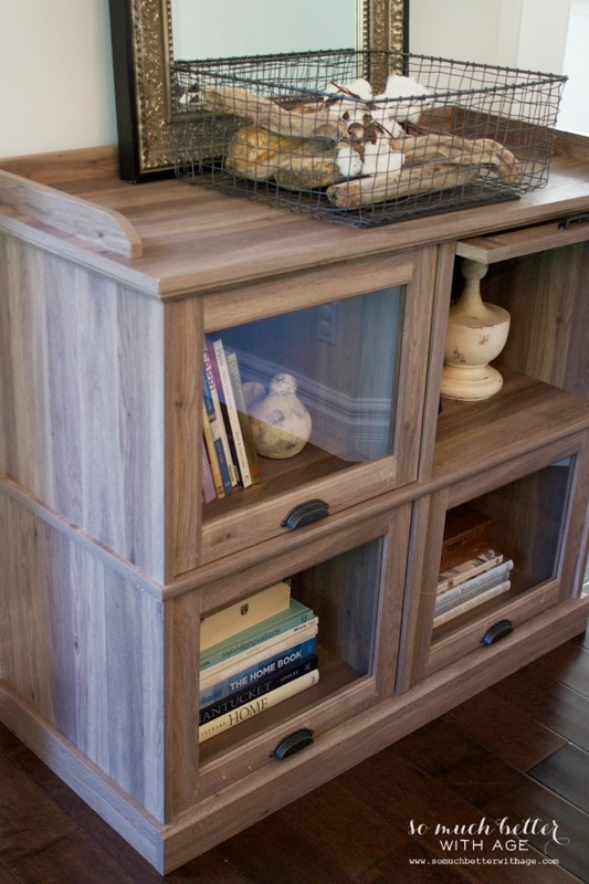 One cabinet styled three ways / books in cabinet - So Much Better With Age