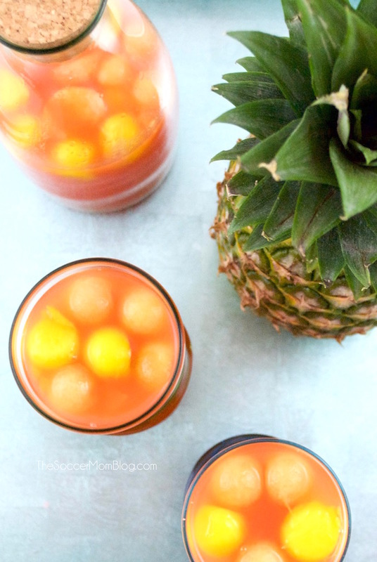 The perfect summer party cocktail recipe: Tropical Rum Punch is like a vacation in your mouth! Easy, gorgeous, smooth, and fruity - it's a crowd pleaser!