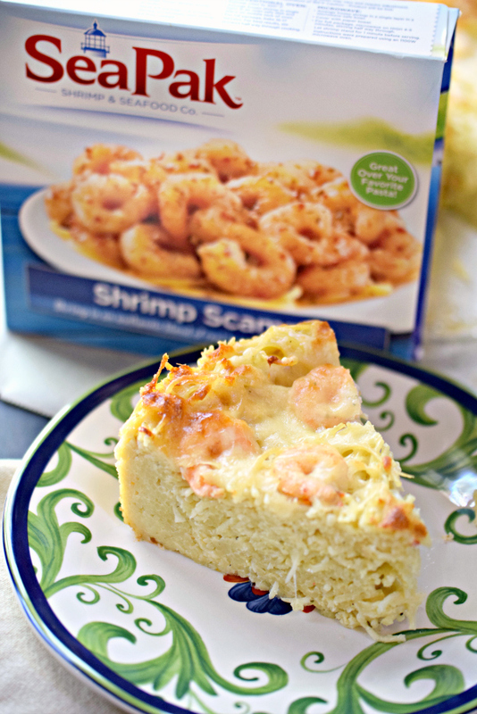 Who knew spaghetti could be such a show stopper! Easy spaghetti pie made with tons of cheese, shrimp, and scampi sauce brings spaghetti to a whole new level!