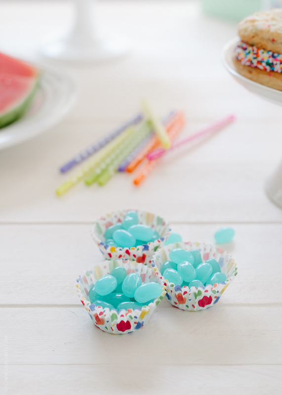 Blue candies filling cupcake liners.