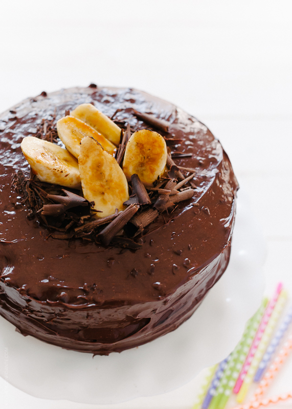 A small cake frosted with chocolate.
