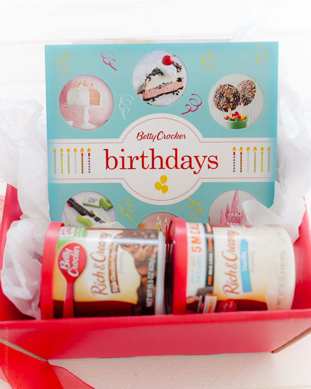 Betty Crocker Birthdays Book and two cans of frosting.