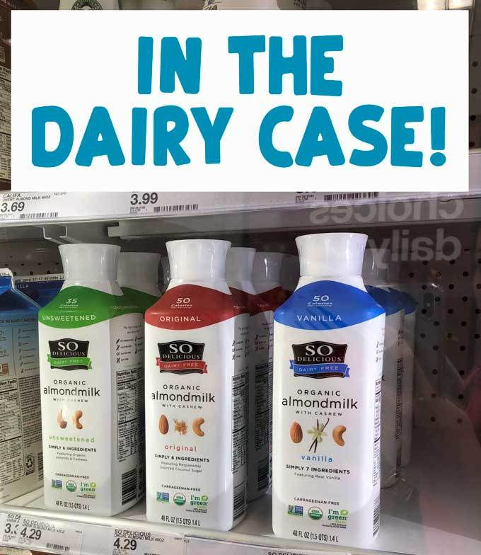 photo of almond milk in store refrigerator and text reading in the dairy case