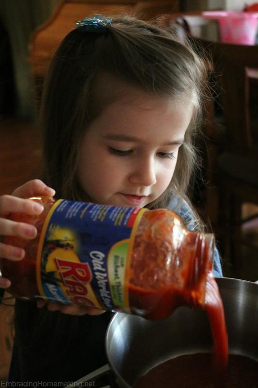 Pouring Rago Sauce