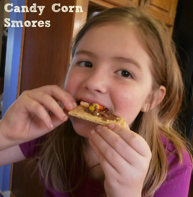 Make S'mores with candy corn and candy corn marshmallows.