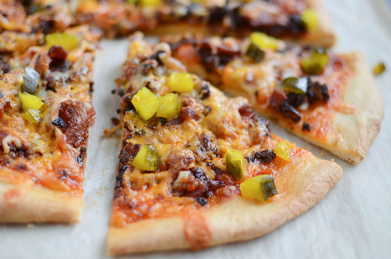 Bacon Cheeseburger Pizza - homemade pizza with burger sauce, ground beef, crispy bacon, 2 kinds of cheese, and pickles! The perfect way to change up pizza night!