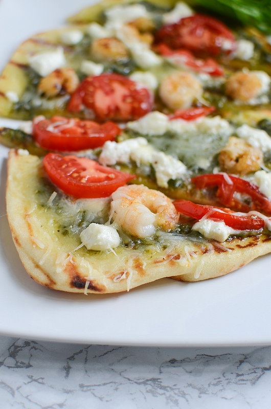Grilled Shrimp and Goat Cheese Pizza - easy grilled pizza on naan bread with homemade pesto, shrimp, tomatoes, and goat cheese!