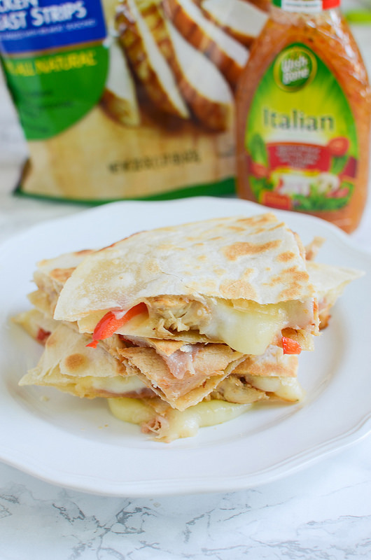 Italian Chicken Quesadillas - delicious 20 minute meal! Chicken, red bell pepper, prosciutto, and provolone cheese on tortillas and cooked until cheese is melty and delicious!
