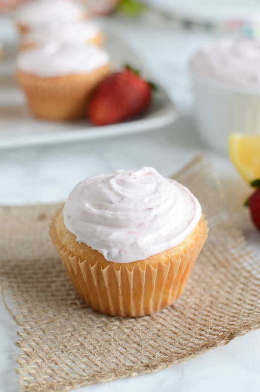 Lemon Cupcakes with Strawberry Frosting - the perfect spring cupcakes! Fluffy cake with the most delicious frosting!