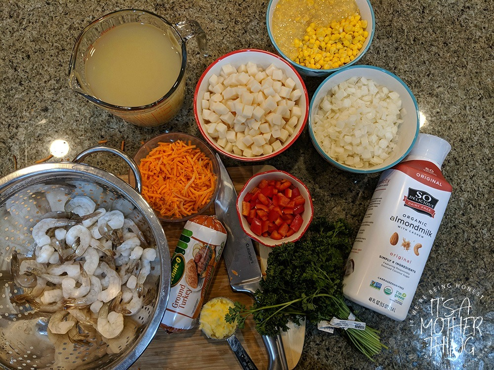 a table full of ingredients for chowder