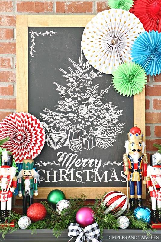 merry christmas chalkboard, paper fan decorations, christmas mantel, nutcrackers