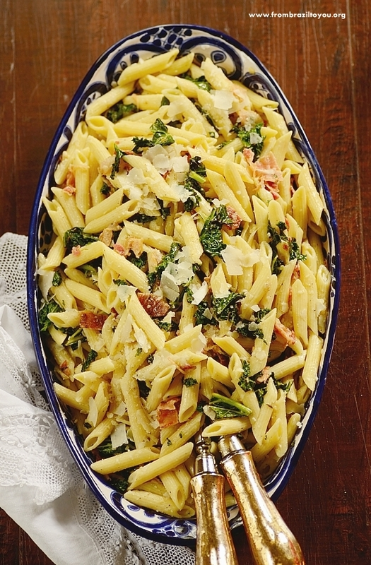 A dish is filled with kale pasta salad