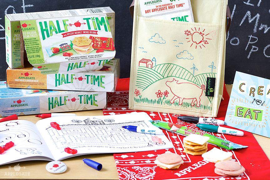 A book on a table with Half Time lunch products behind them.