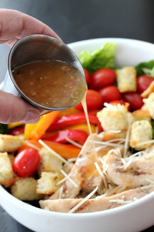 Wishbone Italian Dressing served on a Grilled Chicken salad with homemade croutons