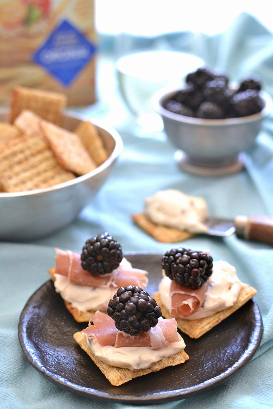 Prosciutto Blackberry Bites with Honey Pecan Cream Cheese, all on a Triscuit cracker!