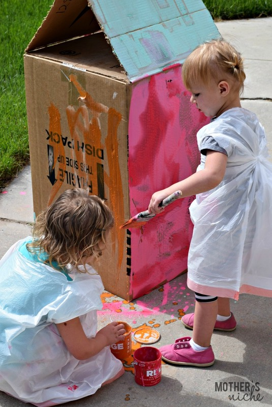 60 Days of Summer Fun: Washable Chalk Painting on a Cardboard House!