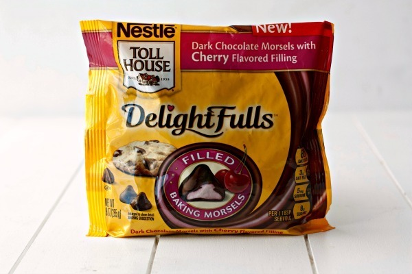 A bag of dark chocolate morsels with cherry flavored filling