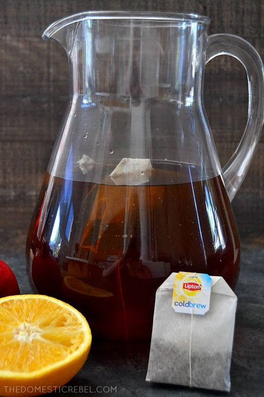 This Spiced Pomegranate Orange Iced Tea is a fantastic reimagined tea recipe! Vibrant oranges, tart pomegranate and spicy cinnamon combine to create this bright and easy iced tea recipe! #BrightBites #ad