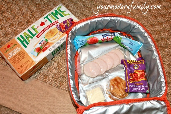 A variety of lunch items in a lunchbox.